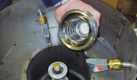 Blowoff metal parts in a vacuum chambe